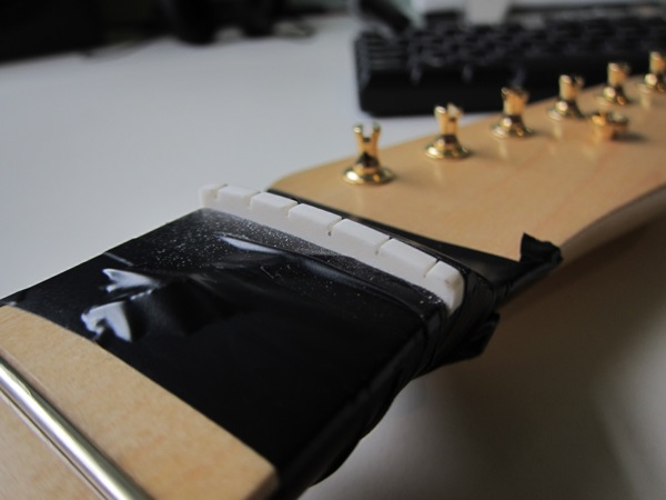 fitting bone nut on guitar